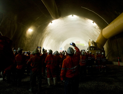 Workers cheer the first TBM breakthrough