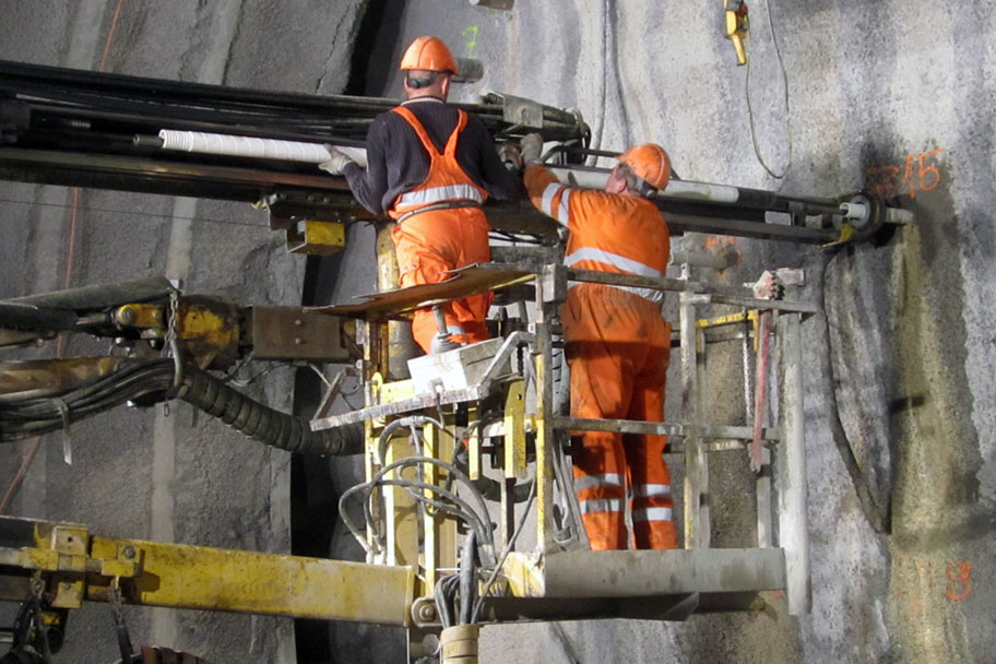 Fibre glass rods being fitted using a jumbo drill rig