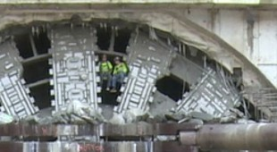 Scale of the 17.48m cutterhead as workers emerge through the spokes