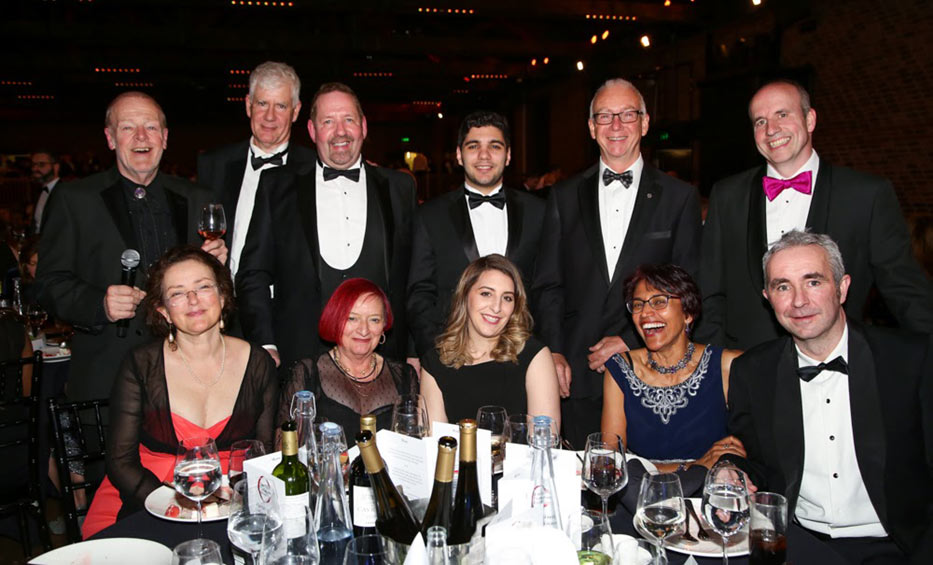 BTS Chair Mark Leggett (standing right) hosted Past Chair Roger Bridge (seated right), speaker Alfie Moore (standing third from left), Harding Prize winner Omar Mohammed (standing middle) and MC John Scholey (standing left) and partners to the top table
