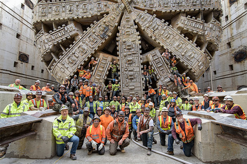 Crew poses proudly with Bertha after operating it to successful breakthrough